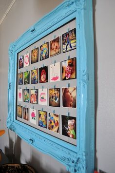 Hang pictures in an empty picture frame (thrift?) that you've spray painted and put a piece of painted cardboard or foam board in the back and hot glue twine to it and hang pics from it.