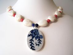 Broken China Jewelry - Blue China Pattern Pottery Shard Necklace - Rosie - White Porcelain Pendant - Coral & White Beaded Necklace. $28.00, via Etsy. love it! #ecrafty