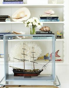California bungalow designed by Krista Ewart. A boat model, shells, and coral reflect seaside life.