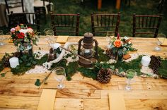 rustic wooded tablescapes of moss, pinecones and lanterns