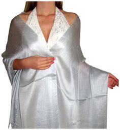 Silk shawls chiffon scarves and wraps tickle my senses.