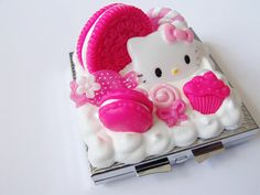 Kawaii Pink Hello Kitty Decoden Mirror by CapricaAccessories, $16.00    not a phone but still cute! pink oreos! :3