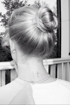 This is it. Cross tattoo on the back of her neck. Simple and elegant.