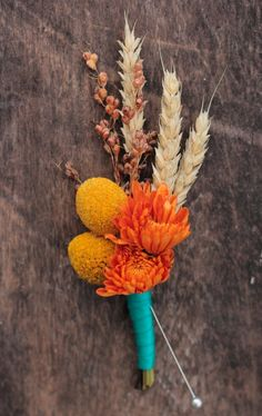 Autumn boutonniere with craspedia, mums, broom corn, and wheat  (wrapped in twine for you)