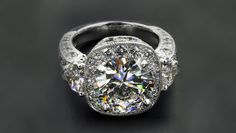 Center diamond is over a carat with two side stones 1/2 carat.  The Halo setting adds another 3/4 carat. 2.35 total weight