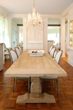 large, old salvaged wood trestle table and vintage French side chairs  (via North Shore Kitchen - traditional - dining room - new york - by AMI Designs)