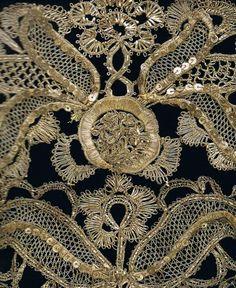 --δ-Θ-Φ-Ω-- : silver thread bobbin lace on a stomacher bodice : 1740