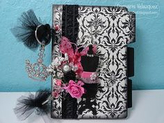 I altered this Teresa Collins tab chipboard album to store my MFT Stamps Die-namics, using what I had in stock.  #damask #dressform #parisian http://atstudiod.blogspot.com/2011/10/mft-die-namics-storage-album.html