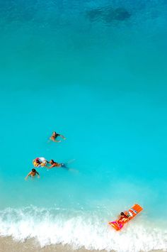 Swimming in the amazing turquoise waters of Porto Katsiki beach ~ Lefkada island, Greece