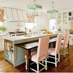 Double-Duty Island | Open shelves keep cookbooks handy at one end of the island, while the microwave is housed at the other. The room's size didn't allow for a freestanding dining table. | SouthernLiving.com