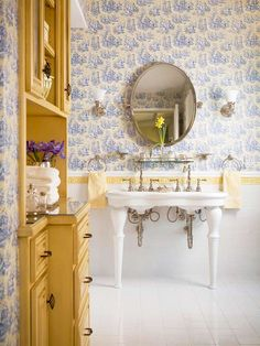 I love that yellow cabinet in the bathroom and how about that double vintage sink?!  Lovely!