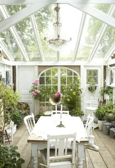 gorgeous sunroom/garden room (LOVE the chandelier)