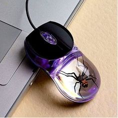 Smithsonian Glow-In-The-Dark Computer Mouse with real Spider inside -- #weird #cool #interesting #mod #geek #science #violet #purple #tech