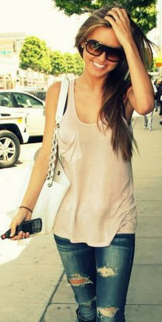 Street style in pocket tank and distressed jeans