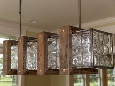 Love Blog Cabin's glass bottle chandelier? Here's how to build your own! >> http://www.diynetwork.com/blog-cabin/how-to-build-a-glass-bottle-chandelier/pictures/index.html?soc=sharingpinterest