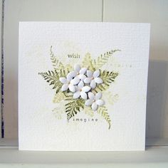 It's 'Less is More' challenge time again – and this week I'm a little earlier than I have been for the last couple of times! The first week of the month theme is colour, and they've set the task of creating a clean and simple card with three shades of green. I used the Hero Arts ferns set of stamps, and Shabby Shutters, Peeled Paint and Forest Moss Distress Inks. A spritz of water, punched flowers and a few drops of liquid pearls and here's my entry: