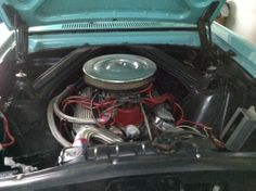 One of only two ways to properly dress an SBF V8 in a Falcon: finned valve covers and a rippled chrome air cleaner.