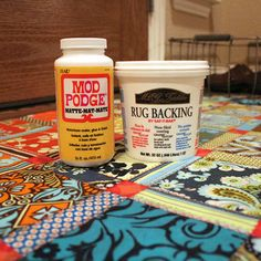 A floor cloth that doesn't slip and slide, or get caught on the door AND is cleanable!  Mod Podge and Rug Backing on fabric make it all possible!