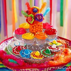 Serve up sweets in a sombrero! Cut off the top of a sombrero and stack cake stands in the middle.