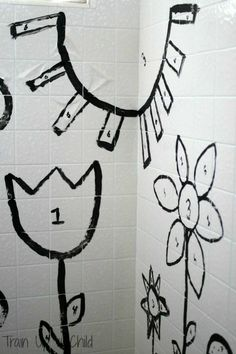 Paint by Number in the Shower {Wash and Learn} Paint a scene in the shower or tub for children to color in reinforcing color recognition and numbers all while getting creative! The best part is that it all washes down the drain when they are done.