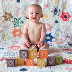 baby picture with blocks- love the quilt background