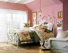 Not a fan of the pink walls but like the iron bed and layered bedding