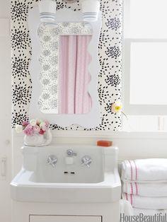 Beach house bathroom. Design: Kristen Ewart. Photo: Victoria Pearson. housebeautiful.com. #bath #bathroom #beach_house #wallpaper #pink_accents