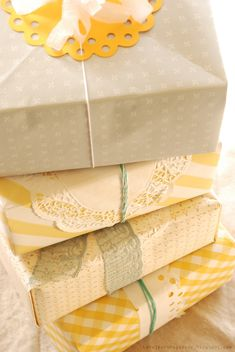 Doilies wrap and origami boxes made of wallpaper..very sweet