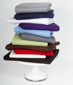 Stack of Colored Fabric on Stand  How to Pair Fabrics With Sewing Patterns Posted by Christine Haynes on Jul 28,