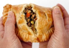 "CURRIED MEAT PIES 4 T oil, divided 1 onion, diced 4 t curry powder 2 t ground cumin 1 t ground coriander 1 T minced garlic 2 T freshly grated ginger 1 lb ground lamb 1 t salt 1 t pepper 1/3 cup dry white wine 1 large boiling potato, ¼"" dice 1 carrot, ¼"" dice 1/2 cup beef or vegetable broth 1/2 cup peas 1/3 cup cilantro prepared pie dough"