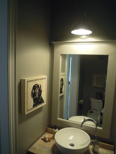 Love the lighting and framed mirror in this bathroom.