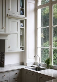 Cabinets and large open window