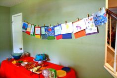 Instead of presents have each party guest bring a pictures they drew themselves that can be part of the party decor