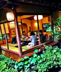 an old style japanese restaurant where every group has a house and gardens all to themselves
