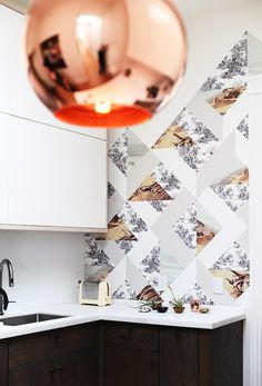 tom dixon lamp + wallpaper by suzanne shade