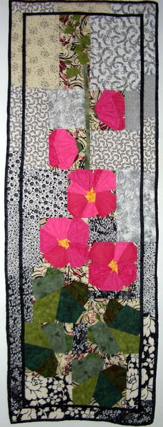 "Hollyhocks Wall Hanging. One Christmas I recieved ""Pieced Flowers"" by Ruth B. McDowell. This was a wall hanging I had to do. I am really pleased with it."