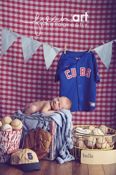 Love this idea for a newborn photo... just will have to change that jersey!! Cardinals should be a perfect fit :)