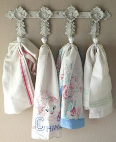 Towels on a pretty hook. Good idea for my vintage towels.