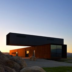One storey hangs precariously over the other at this isolated hilltop house in Australia by architects Denton Corker Marshall.