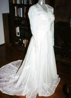 "Rosalie Hierholzer's wedding dress is made from the parachute that saved her future husband's life during World War II. Rosalie's aunt Lora simply cut around the bullet holes. The dress is now on exhibition in ""American Stories."" Blog post and photo of Rosalie's wedding day: http://s.si.edu/ftNZz"