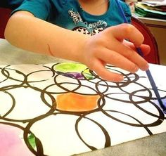 Fun activity for kids! Grab and old cup and either canvas or paper. Dip the cup in black paint have them place it where ever on the paper an paint the empty areas. Fun rainy day art project!!!!
