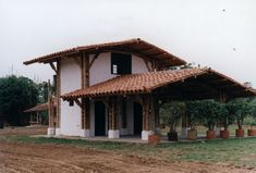 bamboo structure with cementious pedestal & infill wall