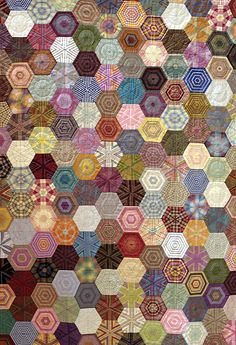 A not-so-crazy crazy quilt of hexagons! Love the symmetry. Nice muted pastel colours, too  Very easy on the eye. Very restful. I can imagine this on a comfy bed in a cozy cabin in the woods...