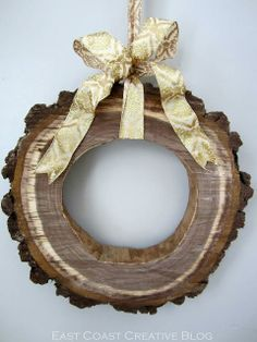 What a neat DIY idea! A rustic wood slice wreath!