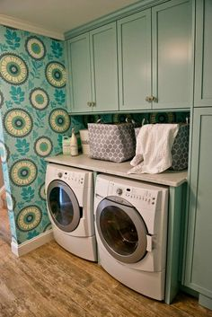 I would actually love doing laundry in this laundry room!  Turquoise and wallpaper!