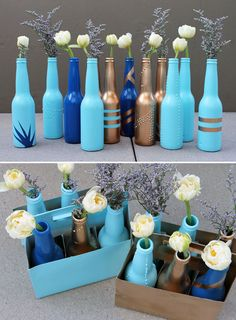 Beer Bottle Bud Vases! In a small town you could ask a bar to keep you a few bottles of different sizes maybe