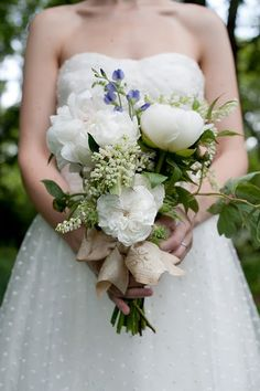 Swiss dot wedding dress and a beautiful bouquet