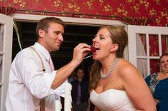 What's more Southern than a delicious red velvet cupcake in a time-honored wedding tradition? Ben feeds his bride a bite of red velvet wedding cupcake   photo credit Priscilla Thomas Photography #weddingcupcakes #cupcakedownsouth