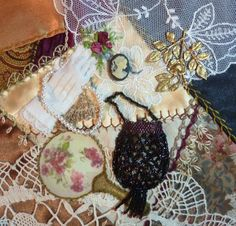 I ❤ crazy quilting & ribbon embroidery . . . Block 03 - Vanity- Mini beaded bag, tiny glove, cameo, corsage, pearl strand, lace handkerchief & dresser hand mirror...all important yet common parts of a Victorian lady's vanity top. ~By Connie Eyberg