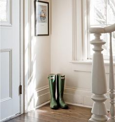 """""""We love the detail and the light of the entryway. It is so inviting. The banister is a piece of art in of itself. The image on the wall is of one of the Maine Island Ferries, which is where Aaron and I met…the rest is history."""""""